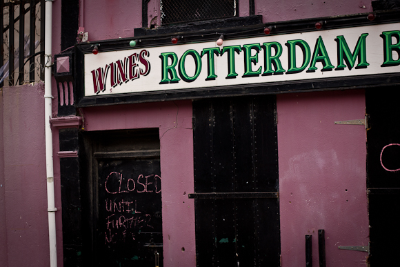 A closed, partially-derelict wine bar in Belfast with a distinctive pink facade