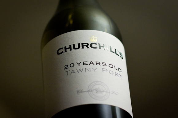 Looking up at a bottle of Churchill's Port. The label's typography is minimal and elegant