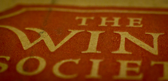 A closeup photo of the logo of the Wine Society on a cardboard box. It's cropped in order that the word 'Wine' appears as 'Win'