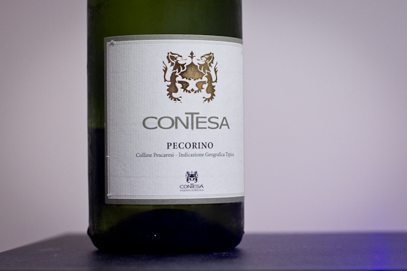 A bottle of Contesa Pecorino. Simple white label with a golden crest and clean, elegant typography