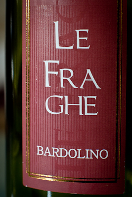 Closeup of the lettering on a bottle of Le Fraghe, an Italian red wine