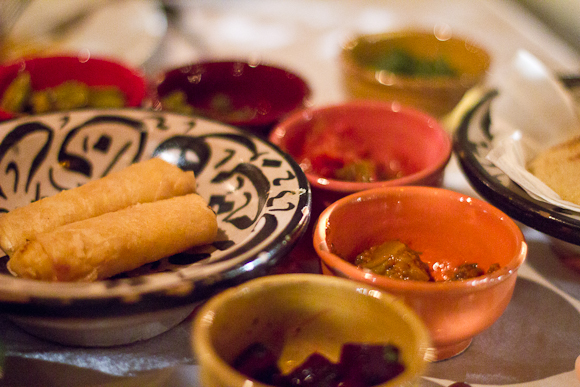 An array of Moroccan starters in beautiful, multicoloured earthenware bowls