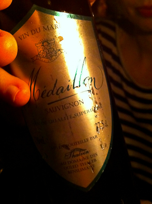 A golden-labelled bottle of Medaillon wine, as served in a Marrakech restaurant