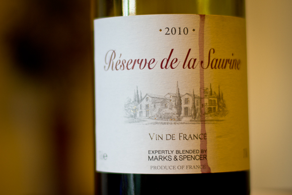 Marks & Spencer's Reserve de la Saurine. The label depicts a French estate (and a drip of red wine has streaked its way down the paper)