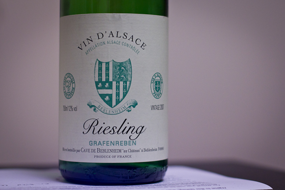 A bottle of Alsace Riesling from Cave de Beblenheim: simple label, two-colour print with crest