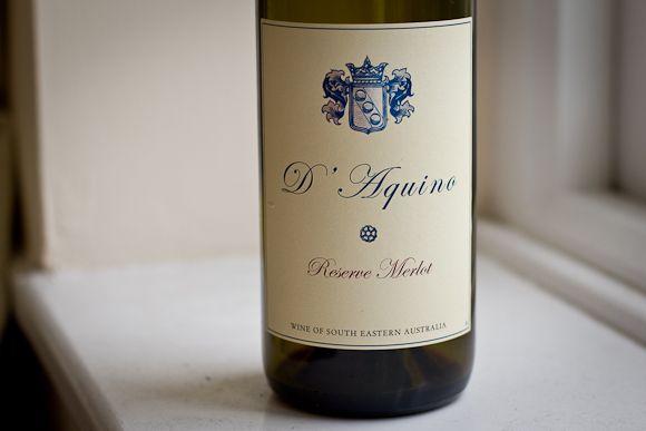 Naked Wines' D'Aquino Merlot: simple label with cursive typography and traditional crest