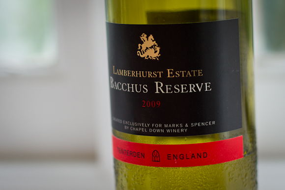 A bottle of English Bacchus from Marks & Spencer. Stylish black, red and gold label