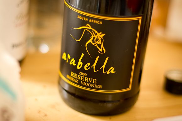 A bottle of Arabella Shiraz Viognier from Naked Wines. Black and bright yellow label, with a line drawing of a horse's head