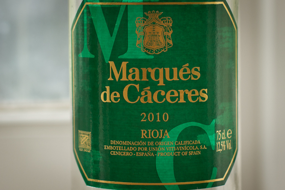 The green and gold label of Marques de Caceres' white Rioja — rather lacking in design style