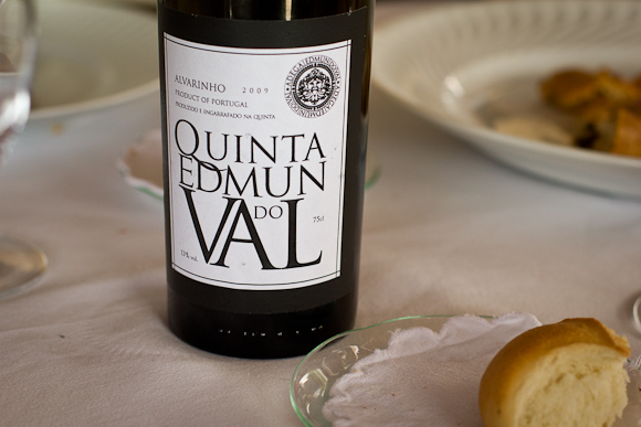 A bottle of Quinta Edmun do Val, with an elegant, minimal, typographic label, executed in black and white