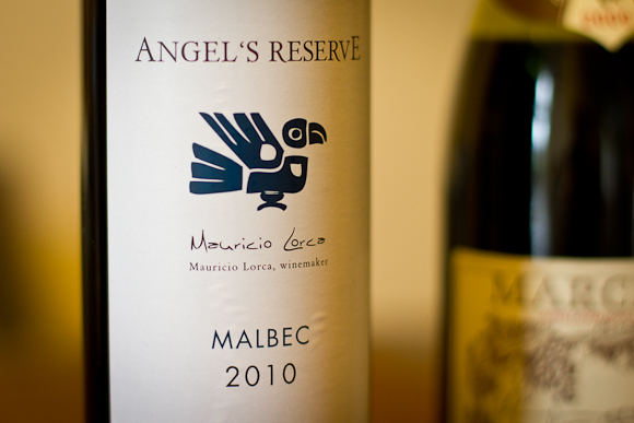 The label of a bottle of Angel's Reserve — decorated with a tribal drawing of a bird