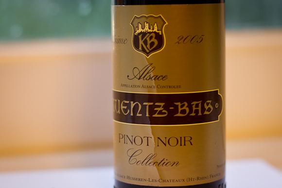Closeup of this Alsace Pinot Noir's label: gold and brown, with a simple crest and typographic focus