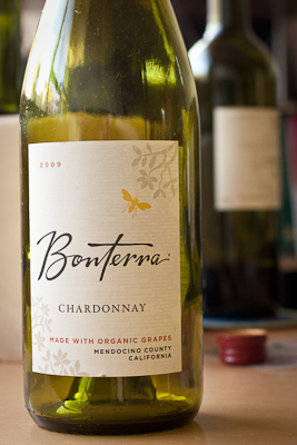 A bottle of Bonterra, label with minimalist floral illustrations and handwritten text. In the background a second bottle, out of focus