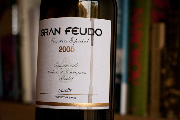 The label of this bottle of Gran Feudo — gold and black lettering, and a dribble of red wine running down it