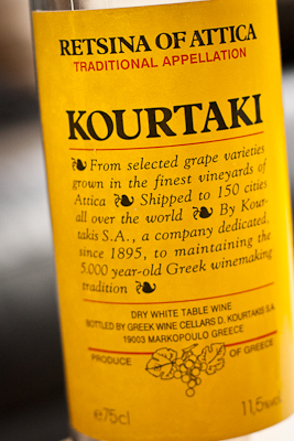 The yellow label of a bottle of Kourtaki Retsina