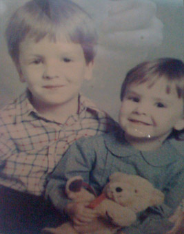 A childhood photograph of Old Parn and his sister (who has a teddy bear)