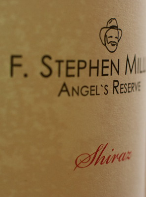Closeup of the label of this bottle of Stephen Miller Shiraz. Typography and line-drawing logo of bearded man in a hat