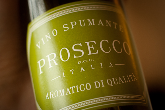 Closeup of the simple green label of a bottle of San Leo Prosecco