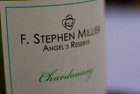 Closeup of the label of a bottle of Stephen Miller Chardonnay, complete with typography and logo — a bearded man's face, complete with hat