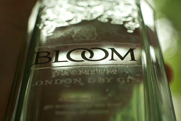 Macro photo of a bottle of Greenall's Bloom, with logo in focus