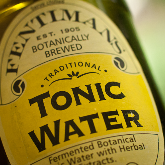 Closeup of the yellow label of a mini-bottle of Fentimans Tonic Water
