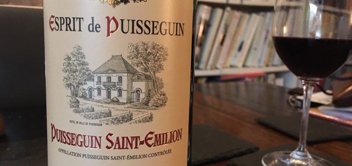 Bottle of red Bordeaux from Esprit de Puisseguin and full glass