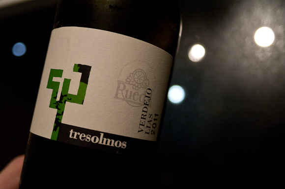 A bottle of Verdejo; in the background, the blurred, rainy street lamps of London