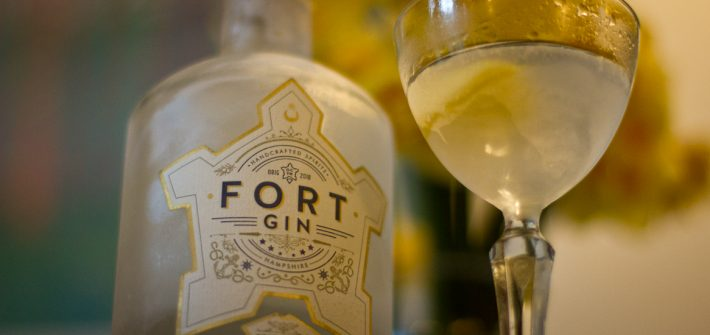 Bottle of Fort Gin alongside a martini