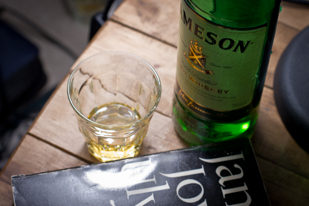 Glass and bottle of Jameson's Whiskey plus a softback edition of Joyce's Ulysses