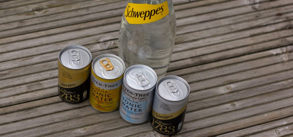 Four tonic water mini cans (Fever Tree and Schweppes 1783) plus a big bottle of Schweppes regular tonic