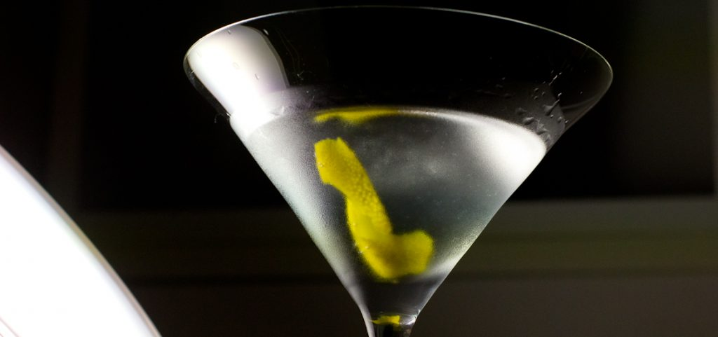 Gin Martini shot from below. Frosted from the cold, with a lemon twist